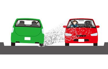 対向車に泥はねをする自動車