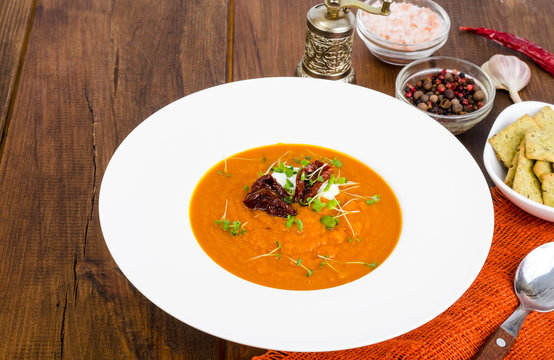 Delicious vegetable cream soup with tomatoes and microgreens.