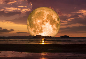 Fond de hotte en verre imprimé Rouge mauve super full moon on the beach and family, Elements of this image furnished by NASA