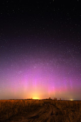 Night landscape with northern lights. Aurora borealis