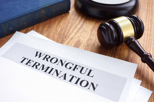 Wrongful termination. Documents and gavel on a desk.