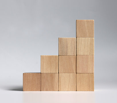A stack of wooden blocks stacked in the shape of a staircase.