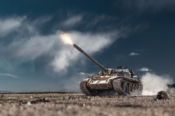 Military or army battle tank firing in the desert war ground. Fire bursting from the gun barrel