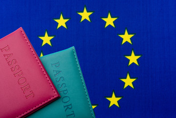 Against the Flag of the European Union are passports.