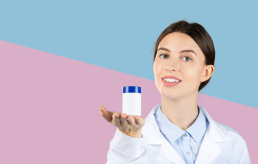 Portrait of female doctor giving you a pills.