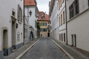 Walk through old buildings in historic center of Lausanne city