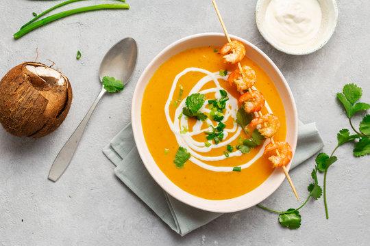Sweet potato soup shrimps bowl top view