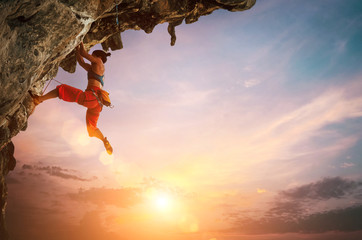 Woman climbing on rock