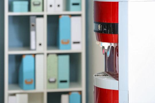 Modern water cooler in office, closeup