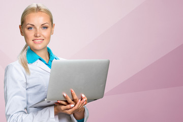Woman doctor with laptop
