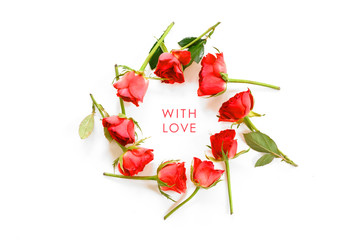 ring from red roses isolated with shadows on a white background, text With Love, copy space, high angle view from above