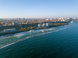 Panoramic bird's eye arial view from drone the coastline of a developed city Odesa, Ukraine. Copy space.