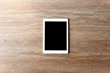 Blank screen tablet copy space Flat lay style on wooden table