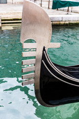 Detail of a gondola on a canal in Venice