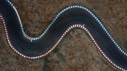 Curving race track view from above, Aerial view car race asphalt track and curve.