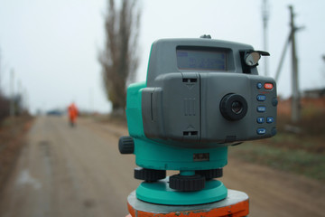 Digital level on the tripod. Leveling, geodetic works