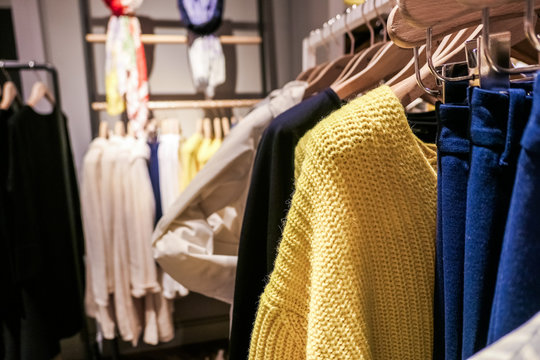 Fashionable casual clothes in a boutique store