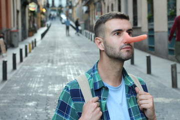 Man with a very long nose outdoors