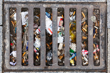 Sewer full of garbage. Urban pollution. Waste treatment. Environmental