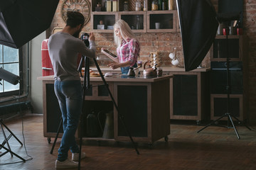 Online restaurant recipe. Woman with tablet. Cooking hobby. Culinary podcast shooting. Backstage photography.