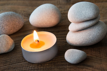 Wellness decoration with candle and stones