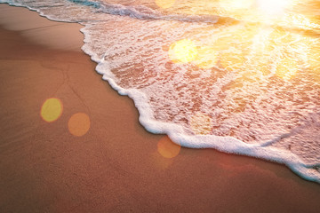 Wall Mural - Sunset beach and smooth wave abstract texture background.