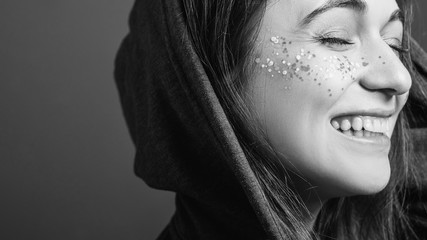 Happy facial expression. Woman youth. Black and white portrait. Copy space.