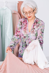 Personal fashion consultant. Successful senior woman. Business and lifestyle. Smart aged lady at showroom workplace.