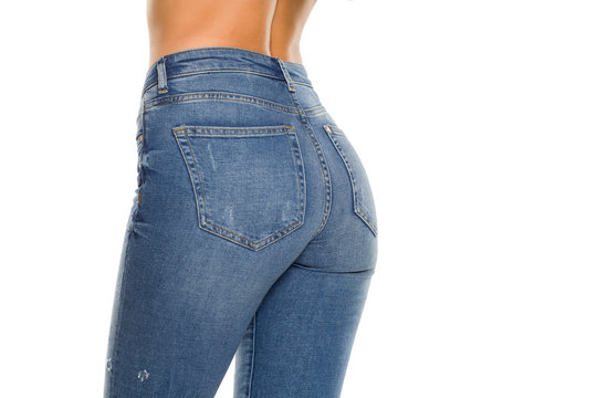 Pretty female ass in jeans on white background