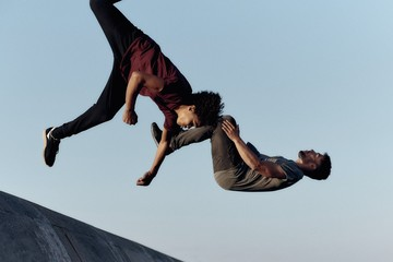 Two guys doing parkour in the street