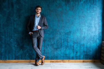 Smiling businessman full length portrait