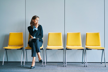Stressful young woman waiting for job interview