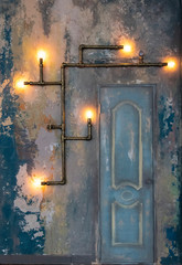 Loft style wall with a door and steampunk pipes