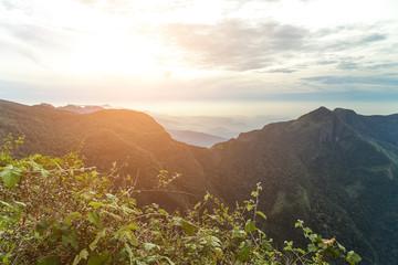 Mountain peaks sunset view cloud forest Worlds End in Horton Plains National Park Sri Lanka.