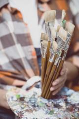 girl painter holds a brush