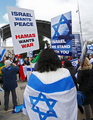 """People hold placards during the """"Rally for Equal Rights at the United Nations (Protesting Anti-Israeli Bias)"""" in Geneva"""