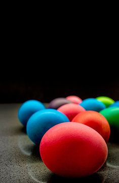Variety of painted Easter eggs on black background