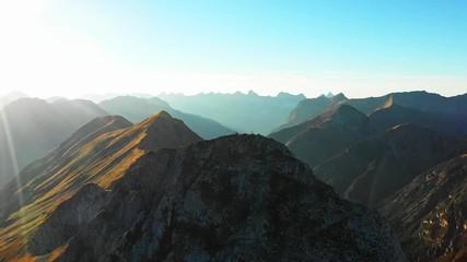 857a5fee510df 0 32 Mountain climbers on Seekarspitze summit with summit cross