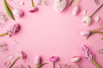 Various of pink flowers on a pink background.