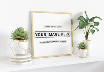 Square Frame Laying on Shelf With Plants Mockup