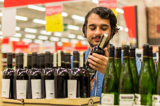 Man buying wine at the market
