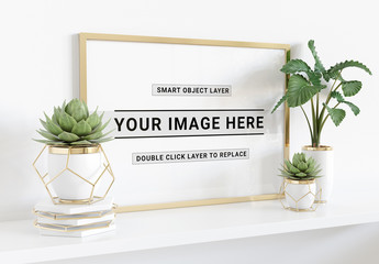 Horizontal Frame Laying on Shelf With Plants Mockup