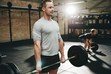 Fit man lifting weights during a gym workout session