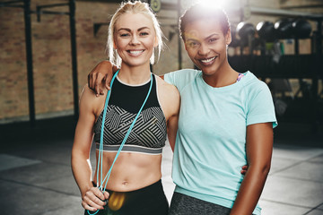 Two young women smiling after a gym workout together