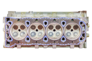 New car engine block with four cylinders isolated on white