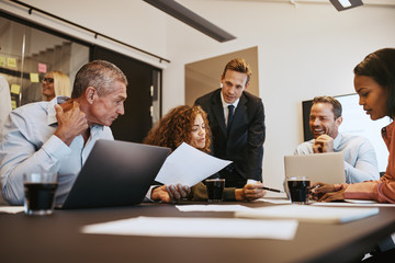 Diverse businesspeople at work together in an office boardroom