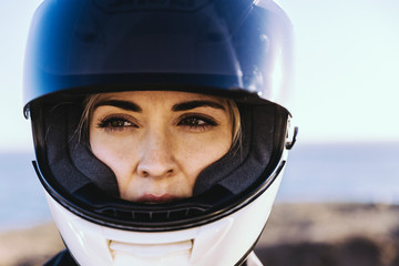 Close up of woman wearing helmet