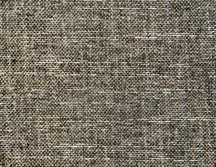 Textured gray natural fabric .