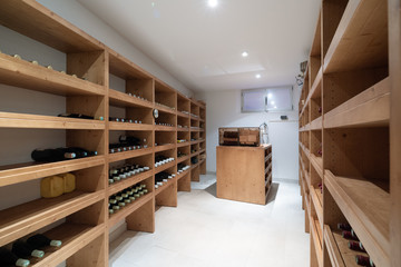 Fototapeta Wine cellar with bottles and cigar humidifier