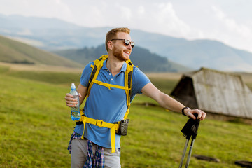 Handsome young red hair hiking man